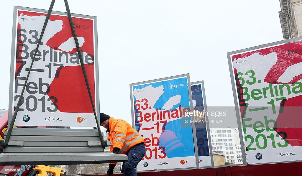 A worker sets up placards advertising the 2013 Berlinale film festivals in Berlin, on Jaunary 2013. The Berlin film festival takes place from 07 until 17 February 2013.