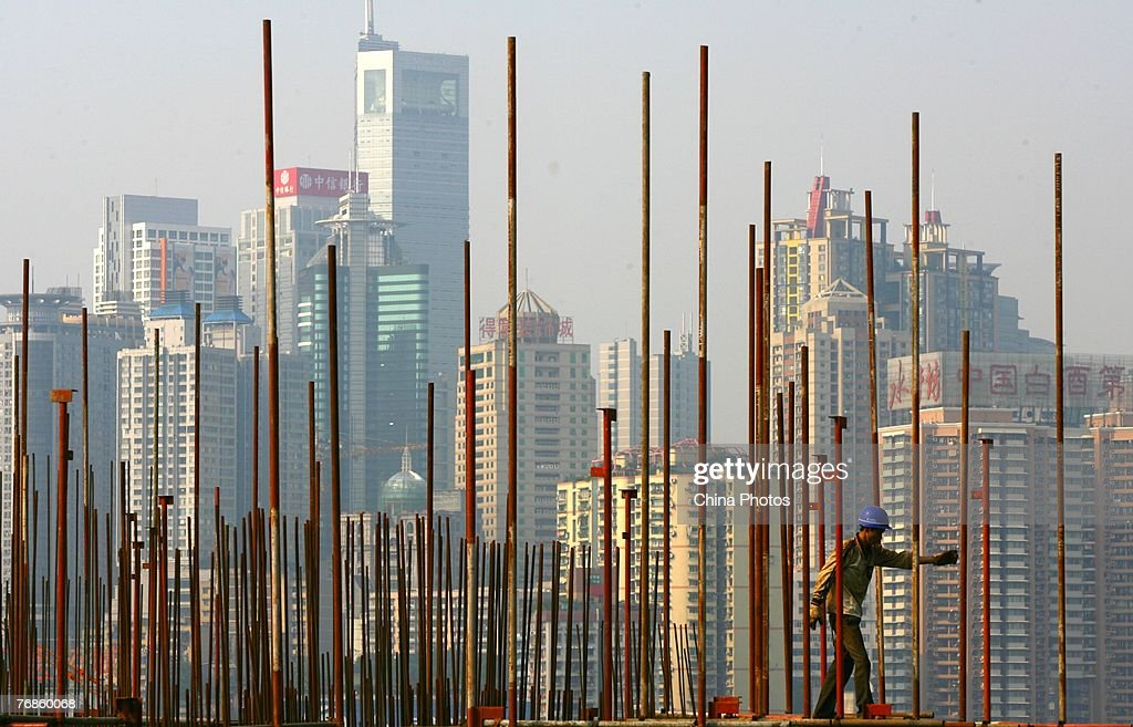 A worker sets up scaffolding at a construction site on September 19, 2007 in Chongqing Municipality, China. China's property investment rose 29 per cent, up from the same period last year to 1.43 trillion yuan (about US$189.9 billion) in the first eight months this year, with the majority going towards commercial housing.