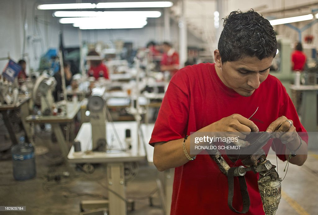 A worker sews a shoe in the factory where the shoes given to Pope Benedicto XVI during his 2012 visit to Mexcio were made, in Leon, Guanajuato State, on March 1, 2013. Benedict has said he will also swap his trademark red shoes for a brown pair also given to him by artisans in Mexico. Benedict XVI became the first Pope to resign in over 700 years on Thursday. AFP PHOTO/Ronaldo Schemidt