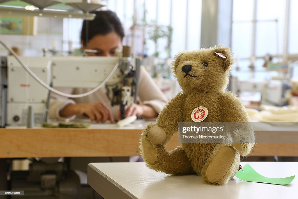 A worker sews at the Steiff stuffed toy factory on November 23 2012 in Giengen an der Brenz Germany Founded by seamstress Margarethe Steiff in 1880...