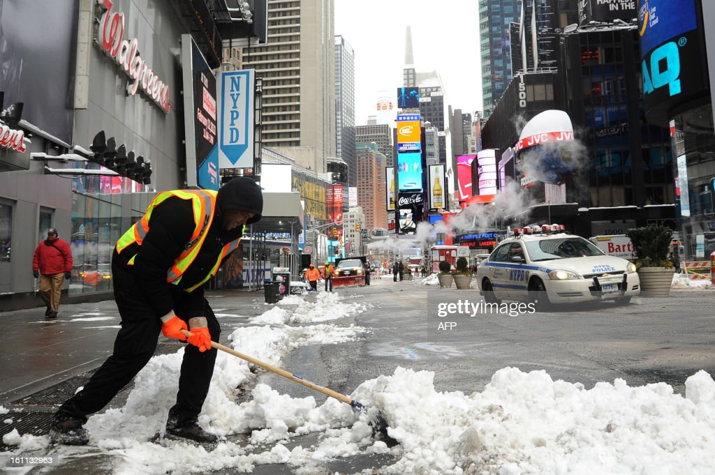 Worker shovel snow in Times Square after winter storm Nemo covered New York City with 4 to 8 inches (10-20cms) of snow on February 9, 2013. The storm was forecast to bring the heaviest snow to the densely-populated northeast corridor so far this winter, threatening power and transport links for tens of millions of people and the major cities of Boston and New York. New York and other regional airports saw more than 4,500 cancellations ahead of what the National Weather Service called 'a major winter storm with blizzard conditions' along most of the region's coastline. AFP PHOTO / MEHDI TAAMALLAH