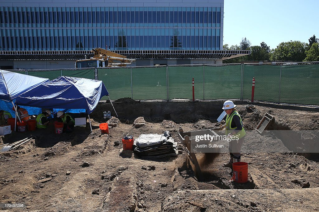A worker sifts dirt that was excavated from an historic graveyard discovered during construction at Santa Clara Valley Medical Center on June 13, 2013 in San Jose, California. Osteologists and archeologists have excavated the remains of 631 people from a construction site at Santa Clara Valley Medical Center along with a number of artifacts that date back to the late 1800s. The excavated graves are bellieved to have been from between the late 1800s and the 1920s. The potter's field, a graveyard reserved for burial of persons who were indigent, unknown or unclaimed, was uncovered by construction crews in February 2012 while doing grading work for the constructin of a new hospital services Building.