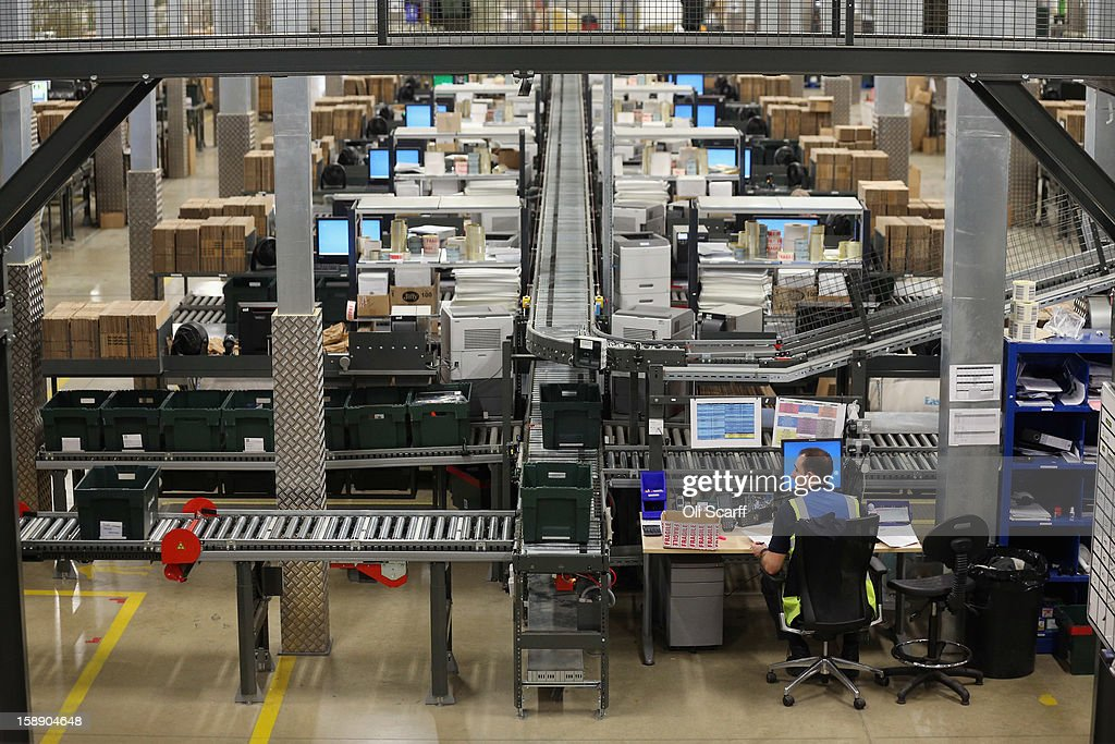 A worker sits behind a computer in the giant semi-automated distribution centre where the company's partners process the online orders for the John Lewis department store on January 3, 2013 in Milton Keynes, England. John Lewis has published their sales report for the five weeks prior December 29, 2012 which showed online sales had increased by 44.3 per cent over the same period in 2011. Purchases from their website Johnlewis.com now account for one quarter of all John Lewis business.