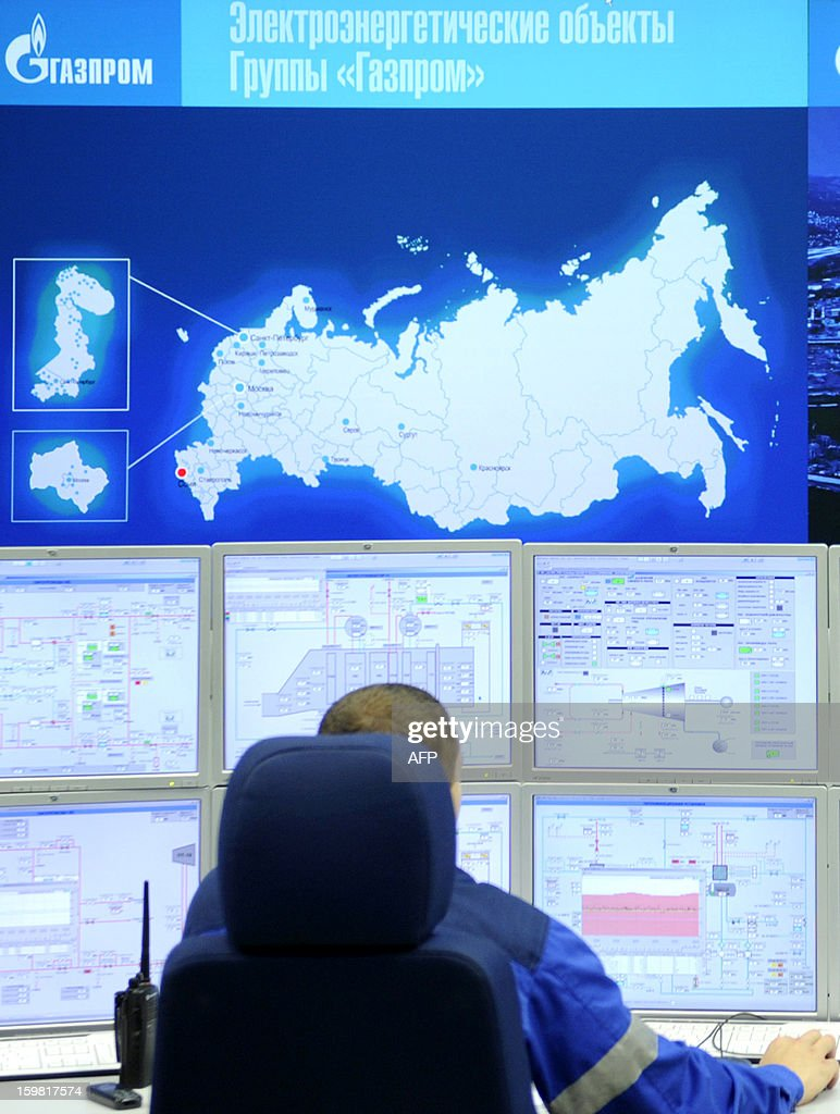 A worker sits in a control room of the recently built Adler thermal power plant in the Russian Black Sea resort of Sochi, on January 21, 2013. The 360 MW Adler thermal power plant will be one of the main sources of power for the coastal cluster of the Sochi 2014 Olympic venues. AFP PHOTO / MIKHAIL MORDASOV