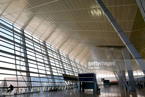 A worker sits in the departures hall in the new terminal under construction at the Ben Gurion International Airport October 21 2004 in Israel The...