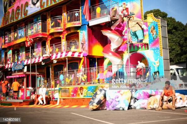 A worker sits on bags of prizes as he takes a break during preparations for 2012 Sydney Royal Easter Show at the Sydney Showground on April 3 2012 in...