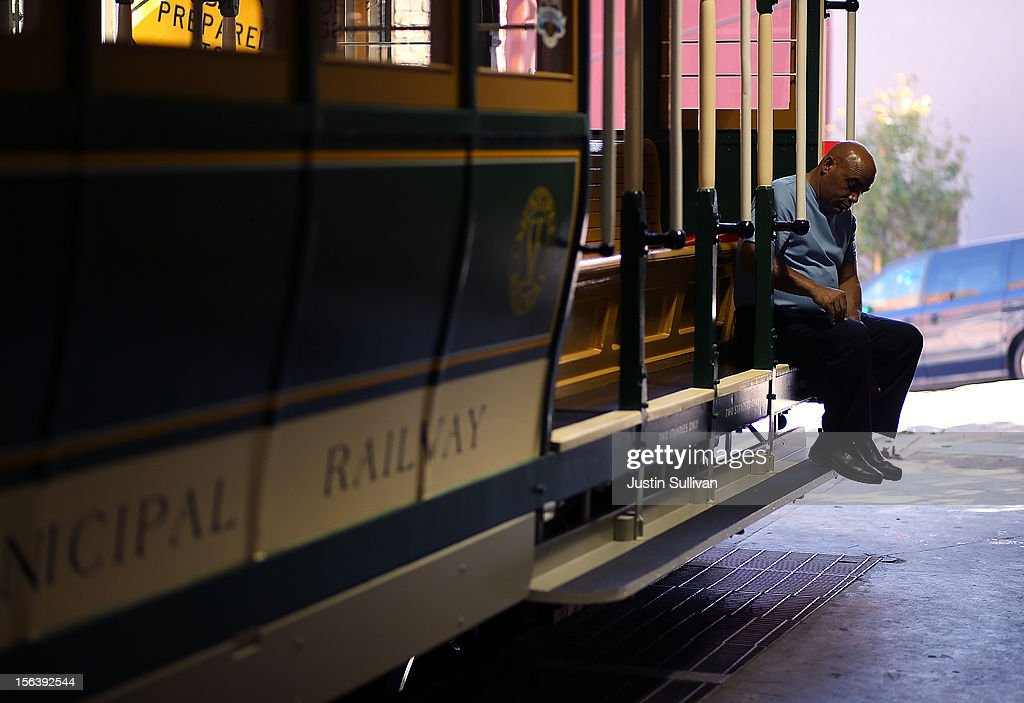A worker sits on San Francisco Cable Car #26 during a service inauguration ceremony for the newly restored vintage Cable Car on November 14, 2012 in San Francisco, California. A service inauguration ceremony kicked off a new life for San Francisco Cable Car #26 that was originally built in 1890 and has been fully restored by hand and put back in service on the streets of San Francisco.