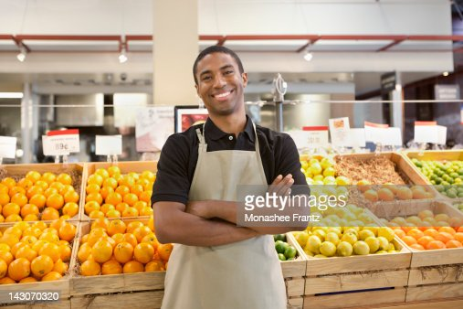 Worker smiling in supermarket : Stock Photo
