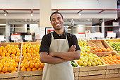 Worker smiling in supermarket