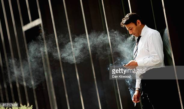 A worker smokes a cigarette outside an office building in the City on September 28 2009 in London England Speaking at the Labour party conference in...