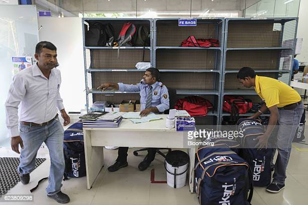 A worker sorts delivery bags inside a Flipkart Online Services Pvt office in the Jayaprakash Narayan Nagar area of Bengaluru India on Wednesday Oct...