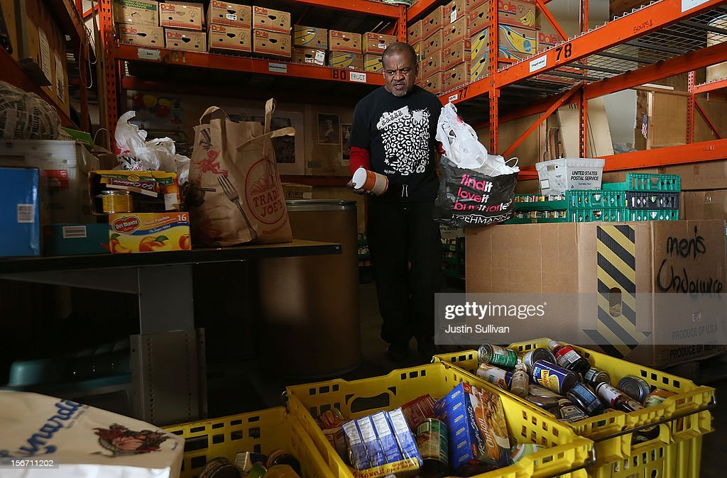 A worker sorts donated canned goods at the Bay Area Rescue Mission on November 19, 2012 in Richmond, California. Days ahead of Thanksgiving, the Bay Area Rescue Mission received a donation of 320 turkeys and 60 hams from local business Bay Alarm that will be used to feed a holiday meal to needy and underpriviledged people.