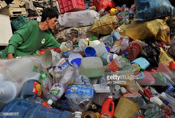 A worker sorts out assorted recyclable plastic at a junk shop in Manila on August 16 2010 Nonbiodegradable plastic is one of the major toxic...