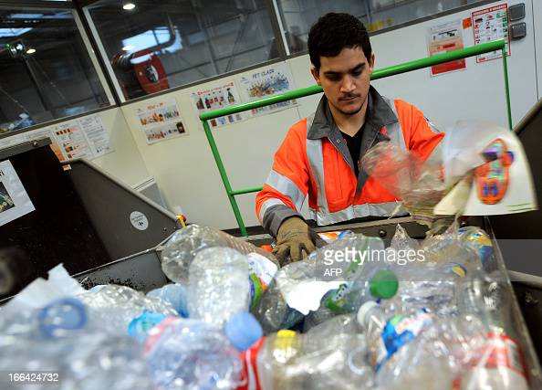 A worker sorts plastic bottles in the recycling plant of waste ValorPôle 72 on April 12 2013 in Le Mans western France ValorPôle 72 is a regional...