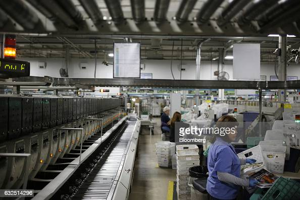 A worker sorts through periodicals at the United States Postal Service sorting center in Louisville Kentucky US on Friday Jan 13 2017 Starting...