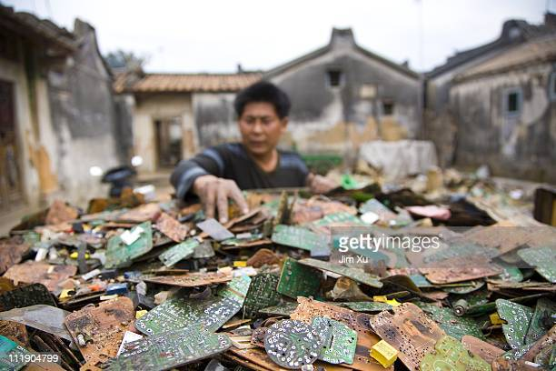 A worker sorts through stripped computer boards March 26 2008 in Guiyu China Since the late 1980's ewaste from developed countries has been imported...