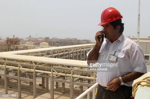 A worker speaks on his walkietalkie during a visit by Iranian Journalists to the South Pars gas field development in the southern Iranian port of...