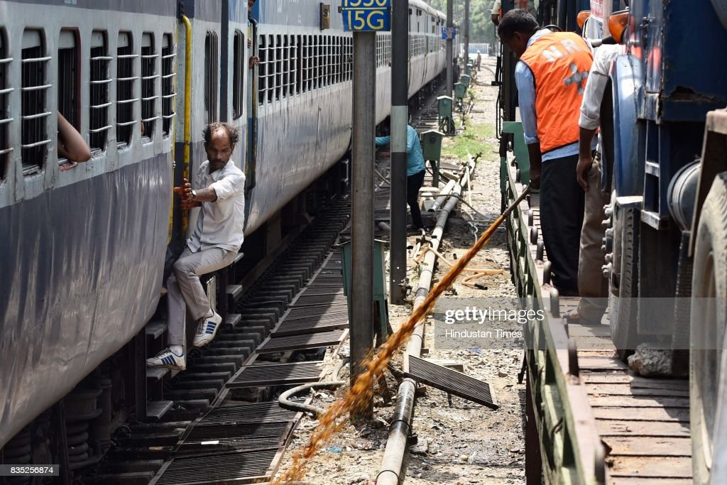 A worker sprays insecticide on area near track with the help of hose from special train on August 18, 2017 in New Delhi, India. Delhi Division Northern Railway and South Delhi Municipal Corporation (SDMC) have collaborated to jointly launch the Mosquito Terminator Special Train to check mosquito breeding alongside the railway tracks. Train will spray insecticide to sanitise water bodies up to a distance of 50-60 metres along the tracks. It is expected to cover a distance of 70 kilometres a day. This year, the authorities have planned eight trips of terminator trains between August 18 and September 16.