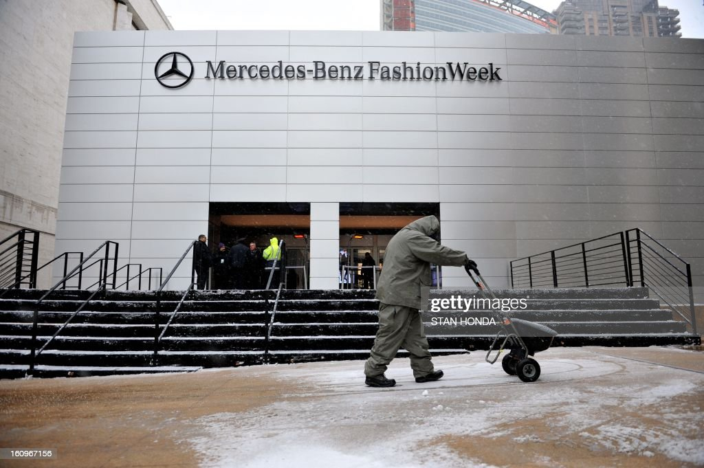 A worker spreads salt as snow began to fall on the plaza in front of the Mercedes Benz Fashion Week tents on February 8, 2013 at Lincoln Center in New York. The first flurries fell Friday over New England in what was forecasted to be an intense snow storm with white-out conditions, fierce winds and significant travel snarl-ups over the next 24 hours. The National Weather Service predicted 'a major winter storm with blizzard conditions' along most of the region's coastline, including the New York area. AFP PHOTO/Stan HONDA