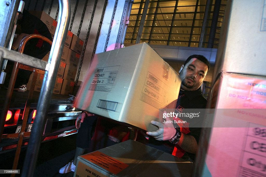 A worker stacks boxes of the new Playstation 3 as they are unloaded from a truck and delivered to the PlayStation store November 16, 2006 in San Francisco, California. People are lining up at electronic stores across the country to purchase the new Sony PlayStation 3 video game console which goes on sale at just after midnight tonight.