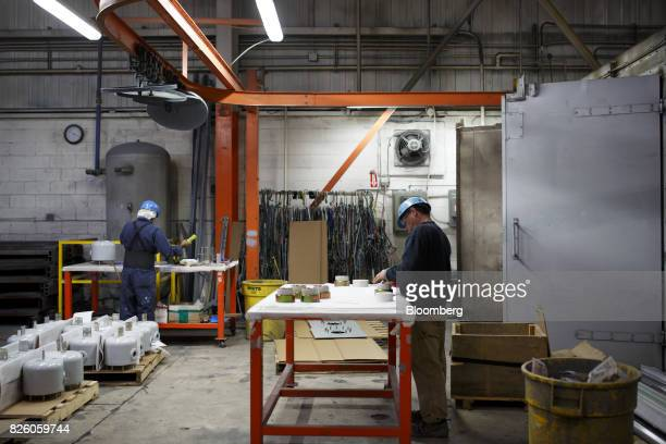 Worker stand at stations at the Automatic Coating Ltd facility in Toronto Ontario Canada on Wednesday Jan 11 2017 Statistics Canada is scheduled to...