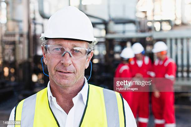 Worker standing at chemical plant
