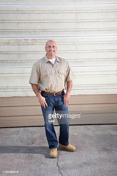 Worker standing in front of warehouse door