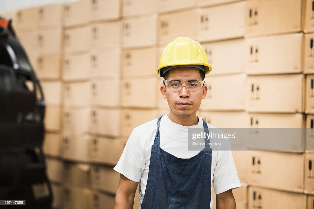 Worker standing in manufacturing plant : Stock Photo