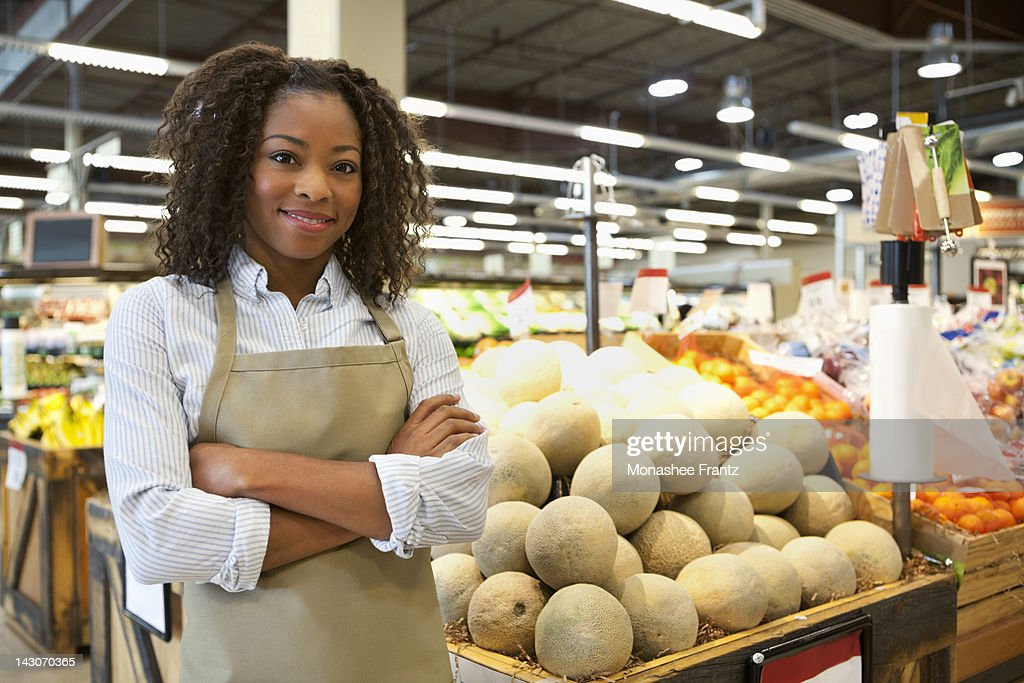 Worker standing in supermarket : Stock Photo