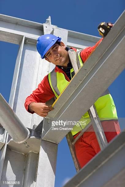 Worker standing on ladder