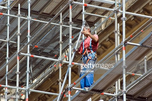 Worker standing on scaffolding