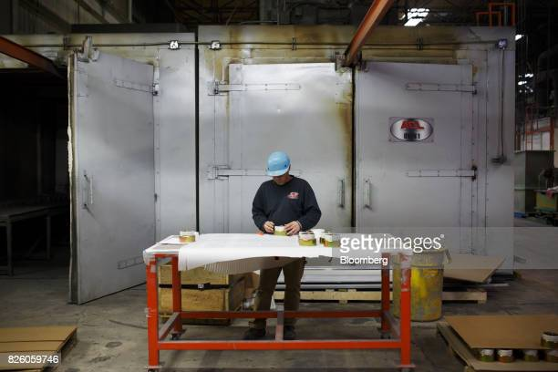 A worker stands at a station at the Automatic Coating Ltd facility in Toronto Ontario Canada on Wednesday Jan 11 2017 Statistics Canada is scheduled...
