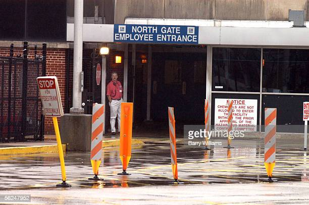 A worker stands at the employee entrance of the General Motors Doraville Assembly Plant November 21 2005 in Doraville Georgia The plant is one of...