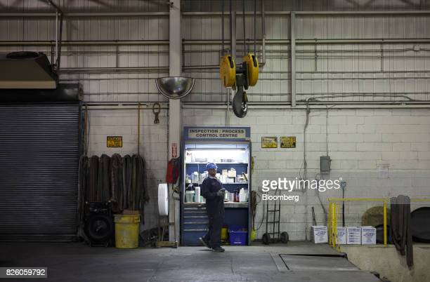 A worker stands at the inspection/process control center at the Automatic Coating Ltd facility in Toronto Ontario Canada on Wednesday Jan 11 2017...