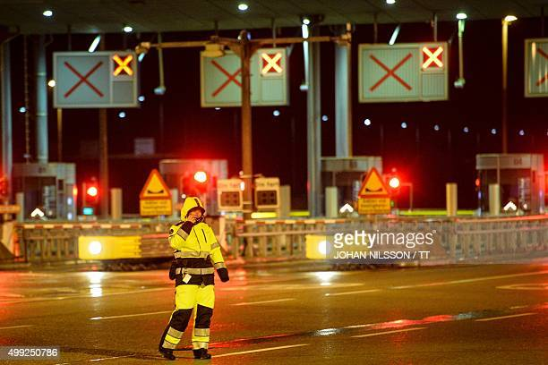 A worker stands at the Oresund bridge which links southern Sweden to Denmark on November 29 2015 as the bridge is closed due to stormy weather AFP...