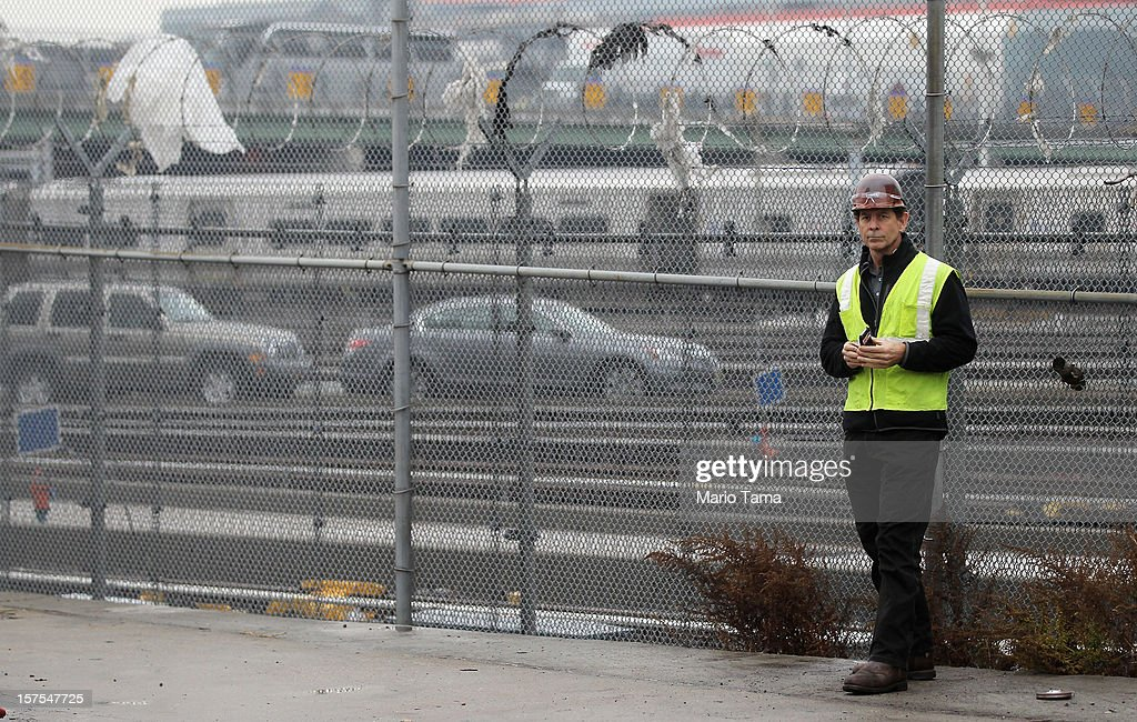 W worker stands before a groundbreaking ceremony for the Hudson Yards development at the site which is expected to boast 13 million square feet of residential and commercial space on a 26-acre site on Manhattan's west side on December 4, 2012 in New York City. The site was the largest undeveloped piece of property in Manhattan and is expected to create around 23,000 construction jobs. It will be the largest private development in the city since Rockefeller Center.