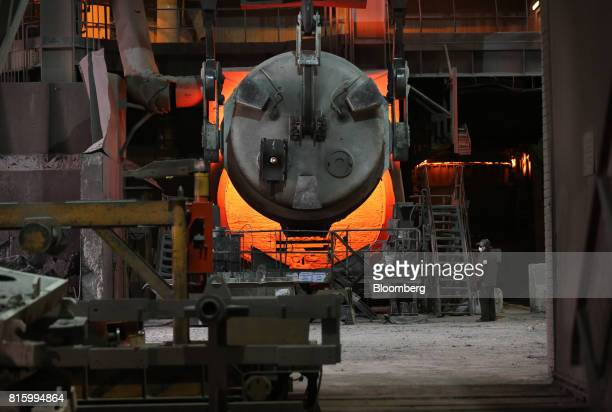 A worker stands by an arc furnace in the steel smelting shop at the Oskol Elektrometallurgical Plant steel mill operated by Metalloinvest Holding Co...