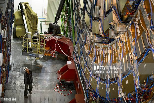 A worker stands by the Compact Muon Solenoid a generalpurpose detector at the European Organisation for Nuclear Research Large Hadron Collider during...