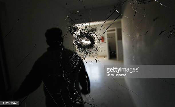 A worker stands in a hallway of hotel that was attacked by Libyan loyalist forces several days ago April 13 2011 in Ajdabiyah Libya The Libyan army...