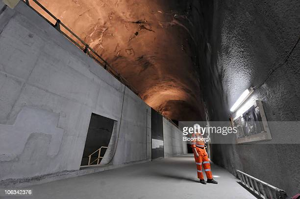 A worker stands in the cavern where the tunnel drilling machine 'Sissi' was assembled in the Gotthard railway tunnel in Erstfeld Switzerland on...