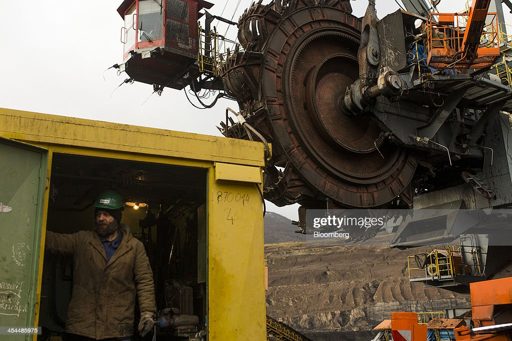 A worker stands in the shelter of a hut during maintenance work on mining equipment used to excavate lignite, also known as brown coal, in the open pit mine operated by Czech Coal AS near the town of Horni Jiretin, Czech Republic, on Friday, Dec. 6, 2013. The government may set up a joint company with Severni Energeticka that will seek lifting current environmental limits on lignite mining, Lidove Noviny reports, citing proposal submitted by Industry and Trade Ministry. Photographer: Bartek Sadowski/Bloomberg via Getty Images