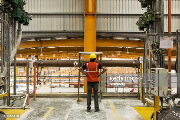 A worker stands inside an Akzo Nobel India Ltd paint factory in Gwalior Madhya Pradesh India on Thursday June 1 2017 Akzo Nobel NV rejected PPG...