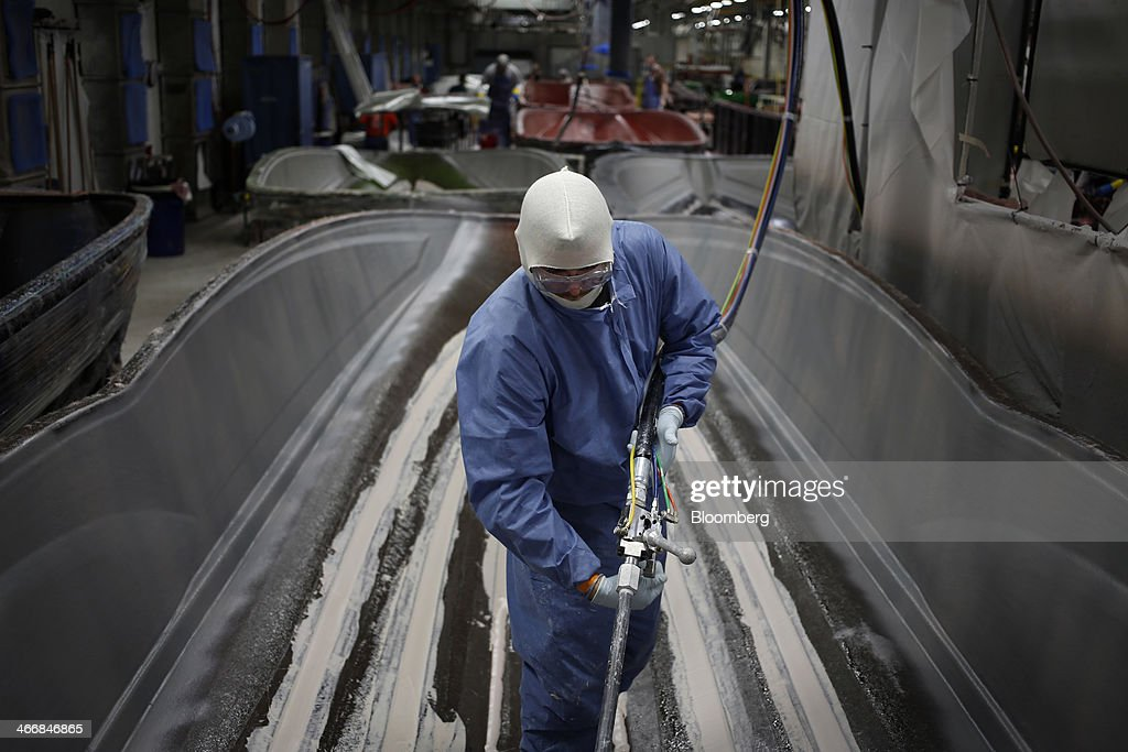 A worker stands inside an inboard speed boat mold on the assembly line at the Mastercraft Boat Co. factory in Vonore, Tennessee, U.S. on Tuesday, Feb. 4, 2014. Orders for U.S. factory goods, excluding transportation, rose .2 percent in December, according to data released by the Census Bureau. Photographer: Luke Sharrett/Bloomberg via Getty Images