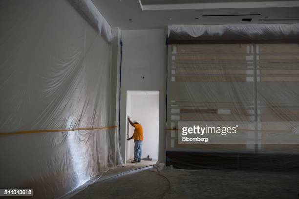 A worker stands inside the convention center of the Irvine Spectrum Marriott International Inc hotel a project of RD Olson Development under...