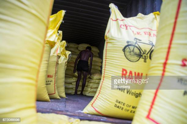 A worker stands near sacks of rice on a truck in the Pettah neighborhood of Colombo Sri Lanka on Thursday April 20 2017 The Central Bank of Sri...