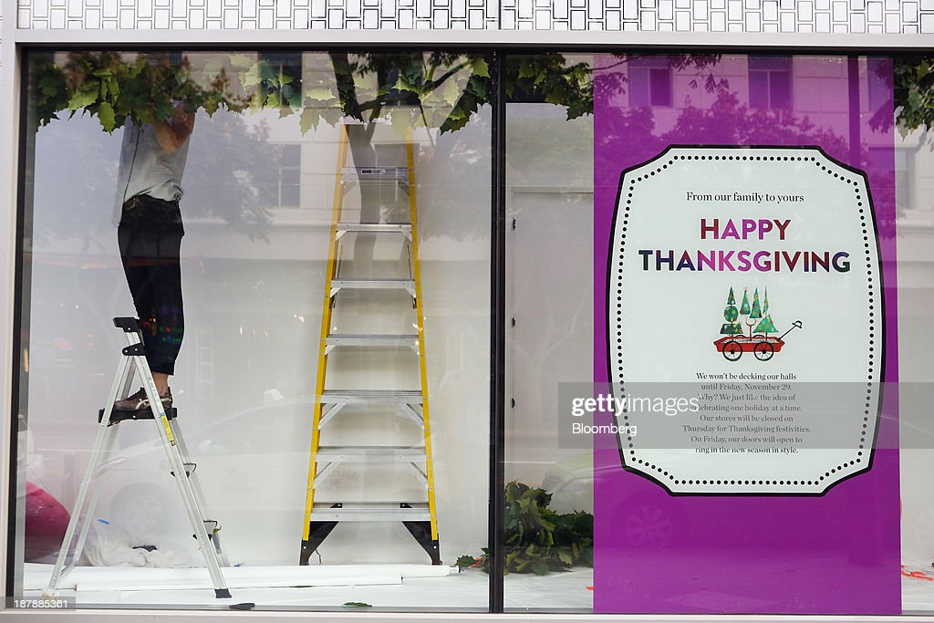 A worker stands on a ladder while installing a window display in preparation for the holiday shopping season at a Nordstrom Inc. department store in Santa Monica, California, U.S., on Tuesday, Nov. 12, 2013. Nordstrom Inc. is scheduled to release earnings figures on Nov. 14. Photographer: Patrick T. Fallon/Bloomberg via Getty Images