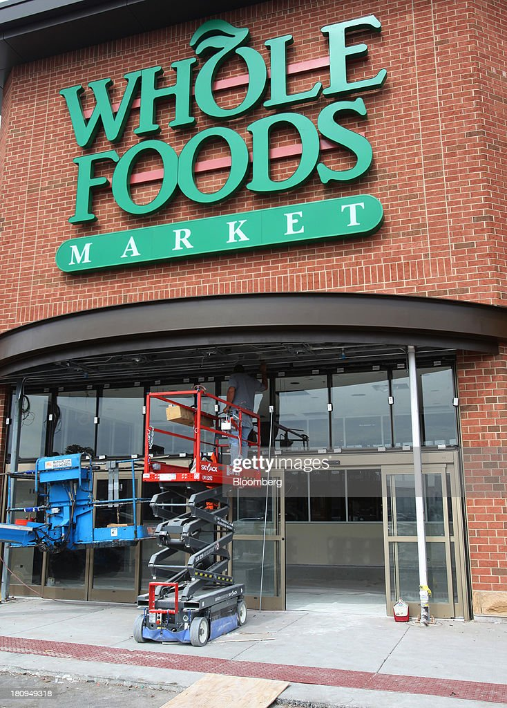 A worker stands on a lift under the awning outside a new Whole Foods Market Inc. store under construction in Park Ridge, Illinois, U.S., on Tuesday, Sept. 17, 2013. Whole Foods is currently scheduled to open eleven new stores in the U.S. and 2 in the U.K by the fall 2014, according to its website. Photographer: Tim Boyle/Bloomberg via Getty Images
