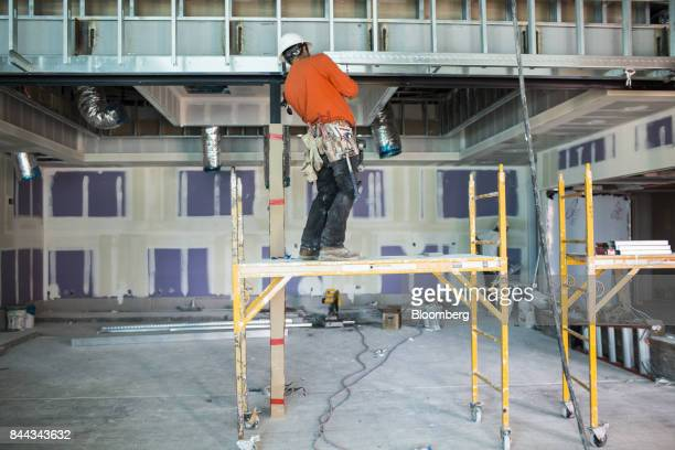 A worker stands on a platform inside the convention center of the Irvine Spectrum Marriott International Inc hotel a project of RD Olson Development...