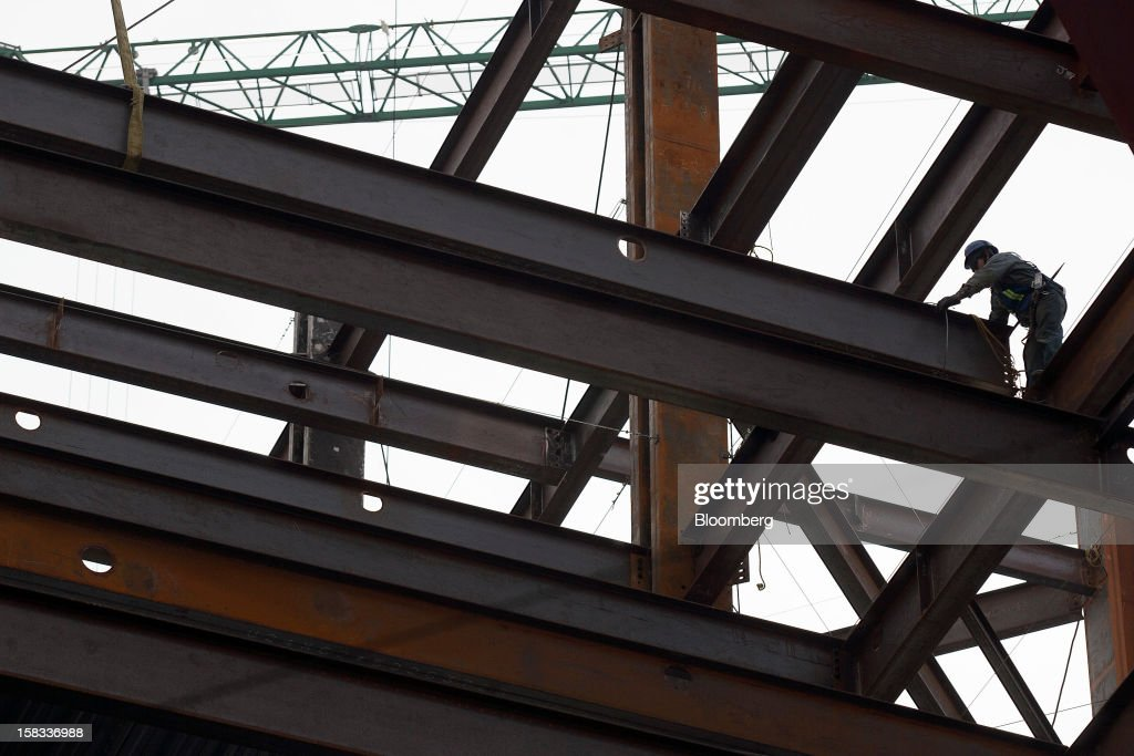 A worker stands on a steel beam at the construction site of the BBVA Bancomer Tower in Mexico City, Mexico, on Thursday, Dec. 13, 2012. The office for BBVA Bancomer, the Mexican unit of Banco Bilbao Vizcaya Argentaria SA, Spain's second-biggest bank, will have 50 floors and accommodate about 4,500 employees when it is completed. Photographer: Susana Gonzalez/Bloomberg via Getty Images
