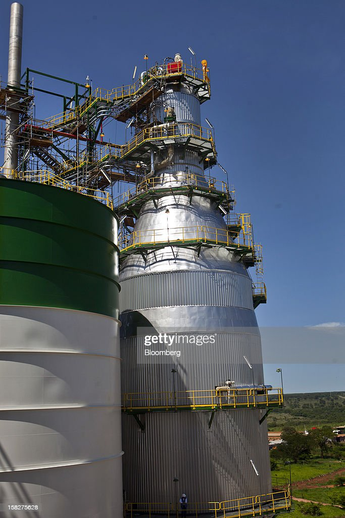 A worker stands on an auxiliary walkway on one of the pulp mills at the Eldorado Celulose e Papel S.A processing plant in Tres Lagoas, Brazil, on Wednesday, Dec. 12, 2012. Eldorado Celulose e Papel S.A is finishing construction on a pulp processing plant that is expected to be one of the the world's largest single-line pulp plants when it reaches peak production. Photographer: Dado Galdieri/Bloomberg via Getty Images